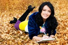 Free Pretty Girl In The Park With A Pen And A Note-book Royalty Free Stock Image - 6644156