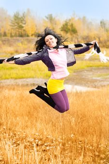 Free Happy Jumping Girl Outdoor Stock Images - 6644524
