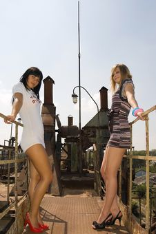 Free Two Young Girls At Old Factory Against A Building Royalty Free Stock Photos - 6647458