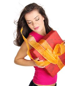 Free Girl Smiles And Holding A Gift Box Stock Image - 6647541