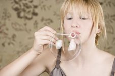 Free Pretty Young Girl Blowing Bubbles Royalty Free Stock Photography - 6648327