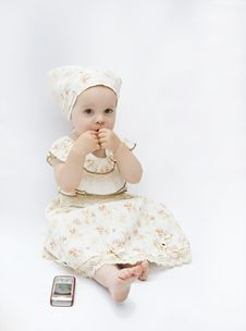 Little Baby Girl With Cell Phone Royalty Free Stock Images