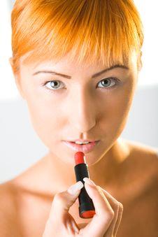Free Woman Applying Lipstick Stock Image - 6649631