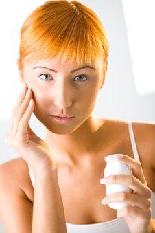 Applying Face Cream Stock Image