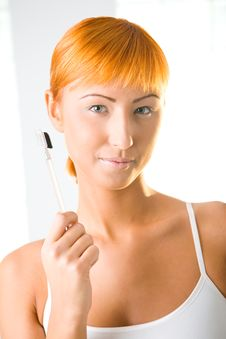Young Woman With Makeup Brush Stock Images