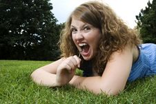 Free Girl In Park Making Funny Face Royalty Free Stock Image - 6651656
