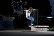 Inline Skater Doing A Grind On Bench Stock Photography