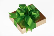 Gold Present Wrapped With Green Ribbons Royalty Free Stock Photography