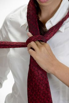 Free Young Pretty Woman Tying Her Tie Stock Photography - 6654842
