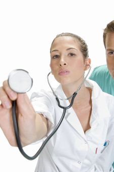 Free Lady Doctor Showing Her Stethoscope Stock Image - 6654871