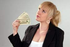 Free Woman Fans Herself With American Currency Stock Photo - 6655200