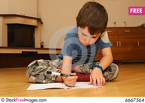 Little boy learning to write Stock Photo