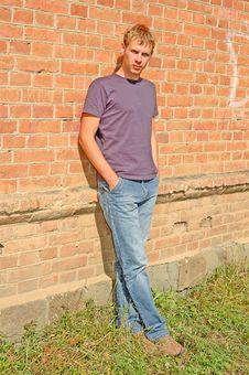 Young Stylish Man Stand Near Brick Wall. Stock Photo