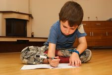 Free Little Boy Learning To Write Stock Images - 6667564