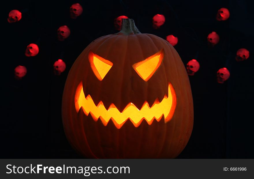 A Jack-o-lantern and Skulls