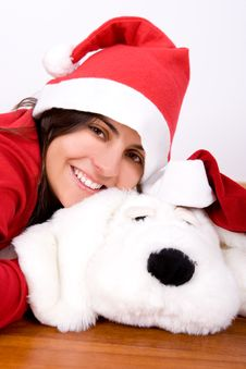 Young Woman Playing With Toy Dog In Christmas Royalty Free Stock Photography