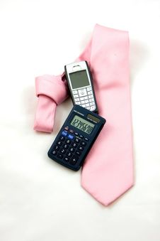 Tie, Calculator And Cell Phone Stock Images