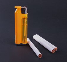 Free Cigarette-lighter And Cigarettes Stock Image - 6674911