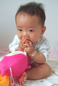 Free Lovely Baby Eating Toys Stock Photos - 6676023