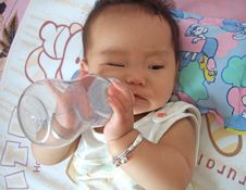 Drinking Water Baby Royalty Free Stock Image