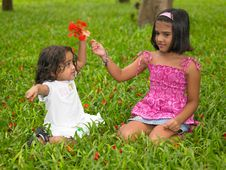 Two Asian Girls In A Garden Royalty Free Stock Images