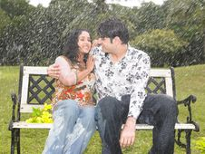 Asian Couple In The Drizzle Stock Image