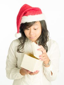 Opening A Christmas Gift Royalty Free Stock Photos