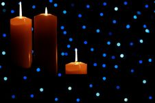 Free Three Large Candles Lit Amongst Blue Lights Royalty Free Stock Photos - 6679618