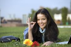 Free Girl With Flowers And Laptop On Grass Stock Photography - 6679672