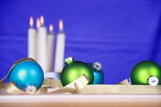 Blue And Green Ornaments With Candles Stock Photo