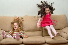 Free Two Little Girls Jumping On Sofa Royalty Free Stock Images - 6679979