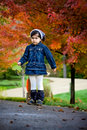 Free Girl And Red Autumn Trees Royalty Free Stock Photo - 6680085