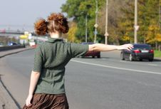 Girl Is Hitch-hiking On Road Royalty Free Stock Images