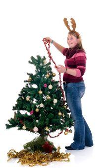 Free Happy Girl Decorating Christmas Tree Stock Photography - 6684032