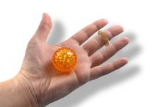 Hand With A Ball For Massage Stock Photos