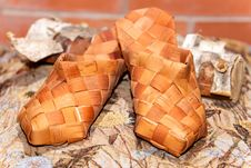 Pair Of Russian Bast Shoes On Birch Log Stock Image