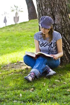 Free Young Enjoying A Book Royalty Free Stock Image - 6690016