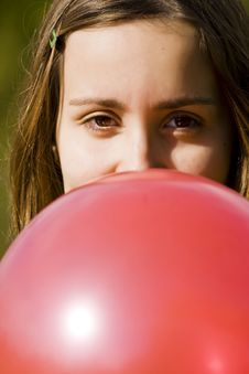 Free Young Woman Inflating Red Balloon Stock Image - 6690151