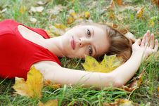 Young Woman And Maple Leaf Royalty Free Stock Photos