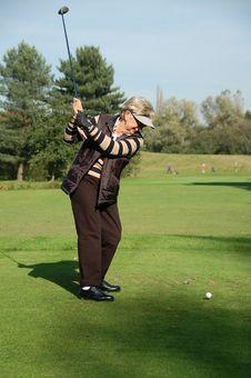 Female Golfer Teeing Off Stock Images