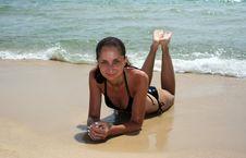 Free Brunette Blying On The Beach Royalty Free Stock Photos - 6690798