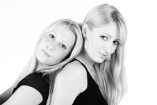 Free Loving Sisters Back To Back Stock Photography - 6692392