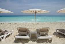 Free Beach View With Lounge Chairs And Umbrella Royalty Free Stock Photo - 6692495