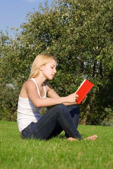 Young Blonde Reads Book Stock Images