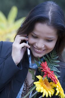 Free Girl With Flowers Tolking By Phone Royalty Free Stock Photo - 6697225