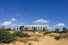 Free Luxury White Spanish Hotel On The Beach Stock Photo - 672990