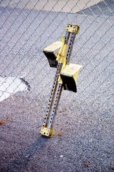 Track & Field Starting Block Against Fence Stock Image