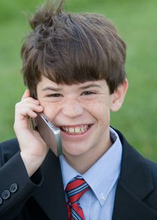 Little Boy On Phone Stock Photo