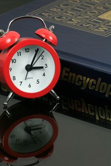 Free Alarm Clock With Encyclopedia Royalty Free Stock Image - 6704026