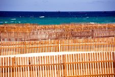 Free Wooden Fence On Deserted Beach Dunes Royalty Free Stock Photography - 6705487